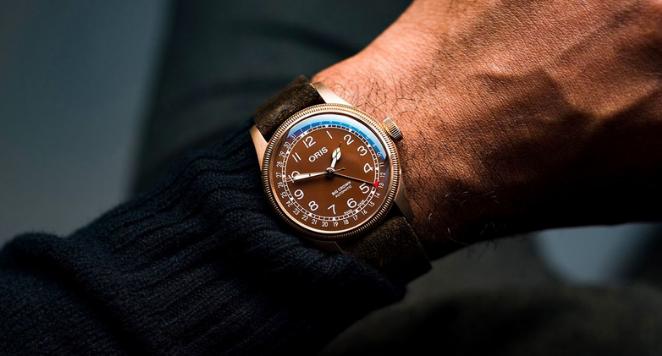 man with bronze watch