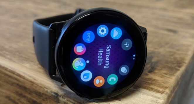 samsung watch on a wooden table