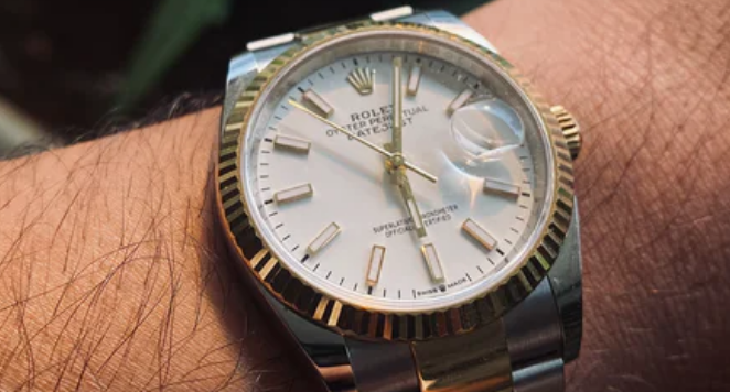 Dual toned Rolex oyster perpetual on a wrist