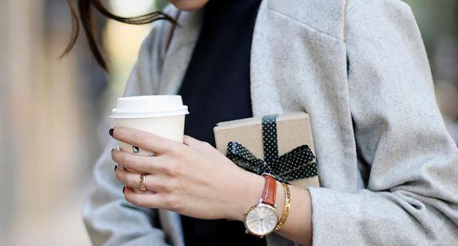 boyfriend watch with brown strap on woman's wrist