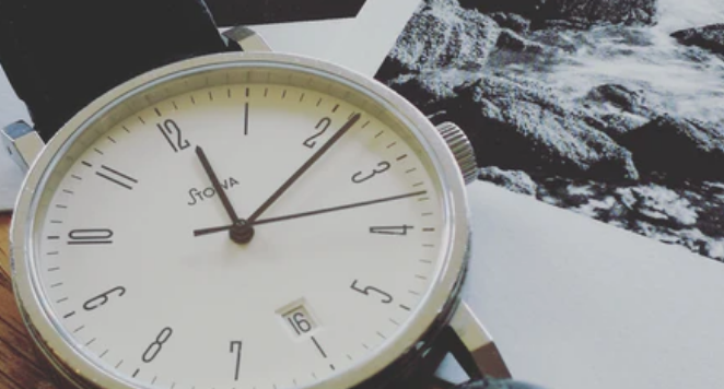 close up of white dial analog watch