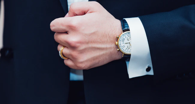 man wearing black and white watch with suit