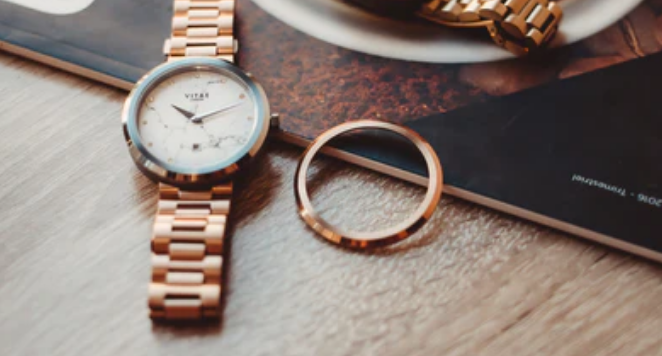 rose gold watches on table