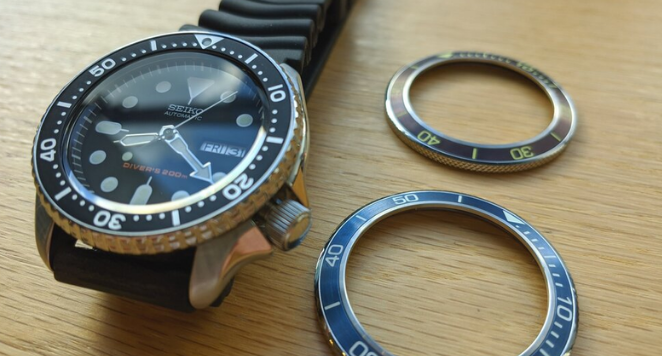 Seiko dive watch  next to two bezels