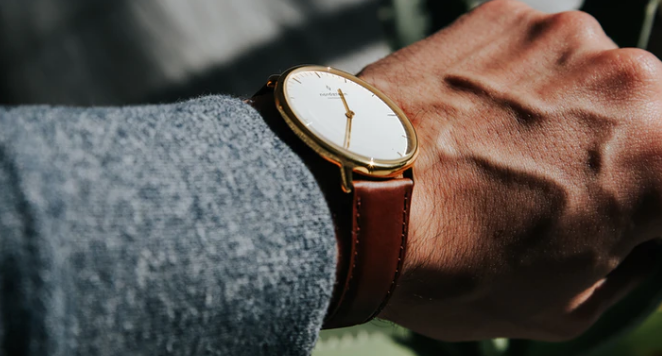 close up of watch with brown leather strap