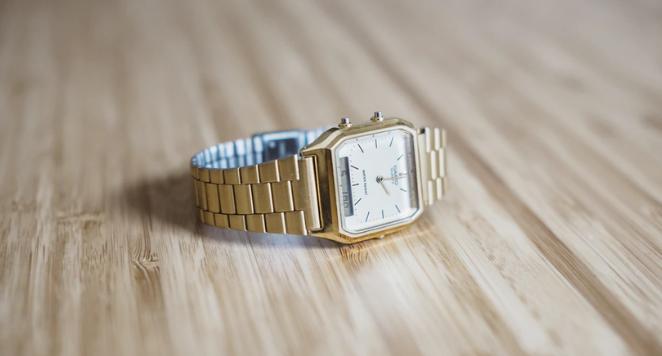 vintage gold watch on wooden floor