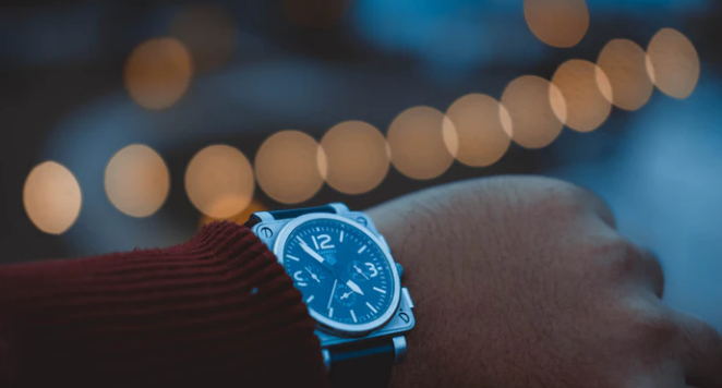someone wearing a watch in the evening