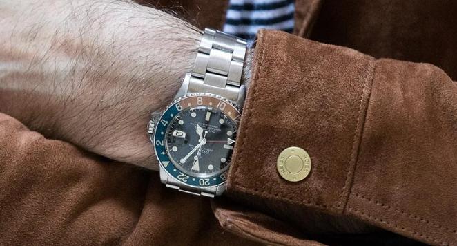 man wearing gmt watch