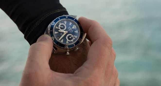 dive watch on man's wrist