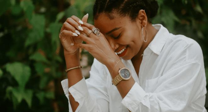 woman laughing wearing watch