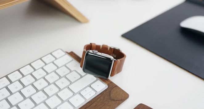 brown watch on modern desk