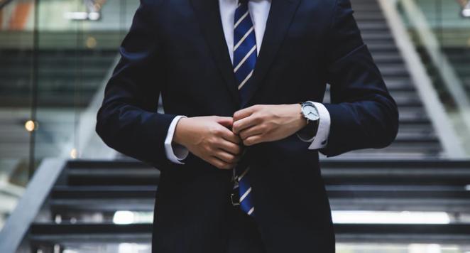 Man in a suit wearing a watch