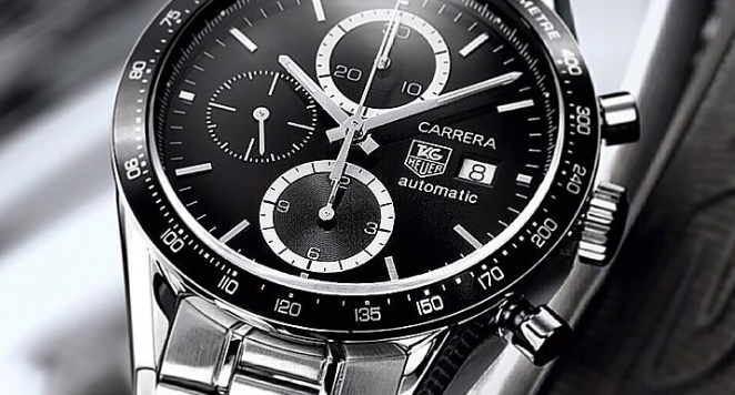 Black and silver TAG Heuer watch