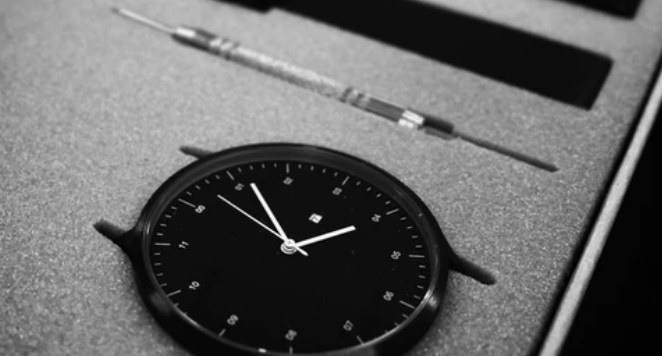 black dial watch and strap changing tool