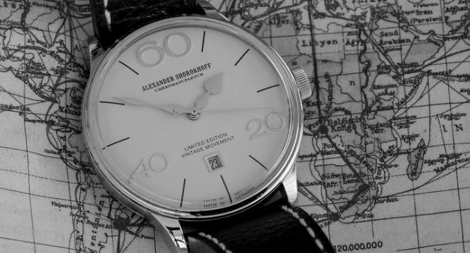 alexander shorokhoff watch placed on a world map