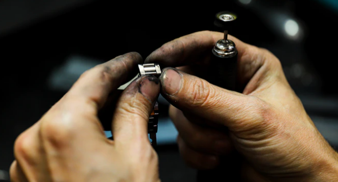 Close up of someone mending a watch