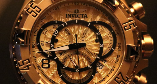 gold invicta watch with gold bezel