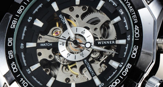 close up of black and silver tachymeter watch