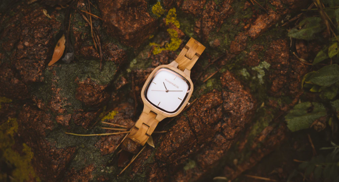 wooden watch on the ground outside