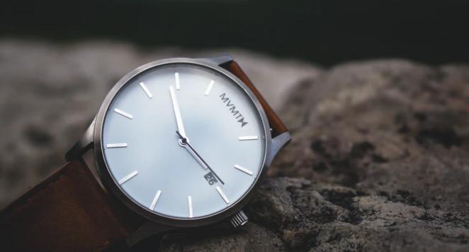 quartz watch on stone wall