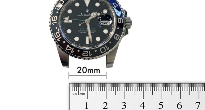 Rolex Oyster Perpetual with ruler below it