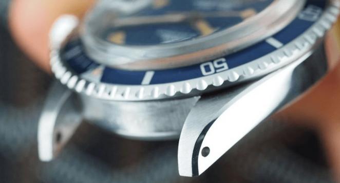 watch lugs and a blue bezel