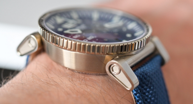 close up of watch on man's wrist with watch lugs