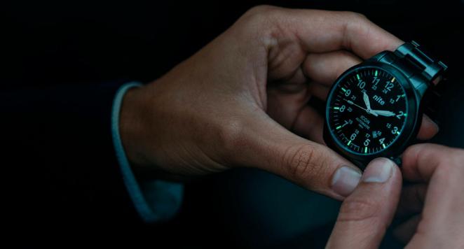 Holding a luminous watch